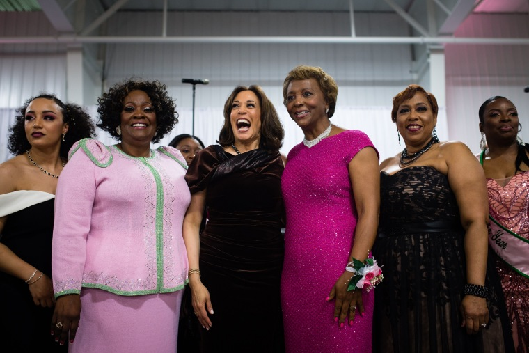Image: Senator Kamala Harris stands with attendees at the Alpha Kappa Alpha sorority gala in Columbia, South Carolina, on Jan. 25, 2019.