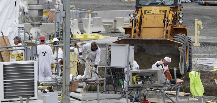 Image: Workers at the 'C' Tank Farm at the Hanford Nuclear Reservation
