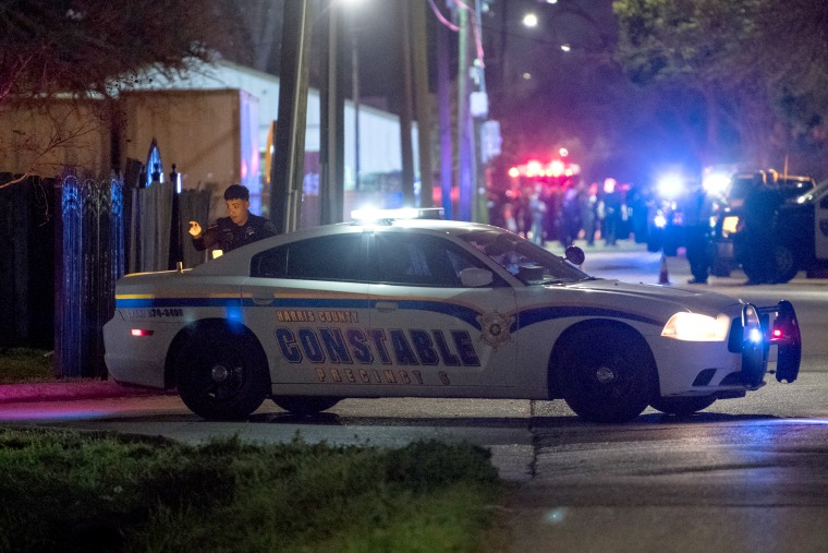 Image: Law enforcement secure the scene of a shooting that injured five Houston police officers on Jan. 28, 2019.
