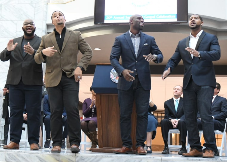 Members of the NFL Players Choir Terrence Stephens, Olrick Johnson, Bryan Scott and Cameron Newton perform during a press conference in Atlanta