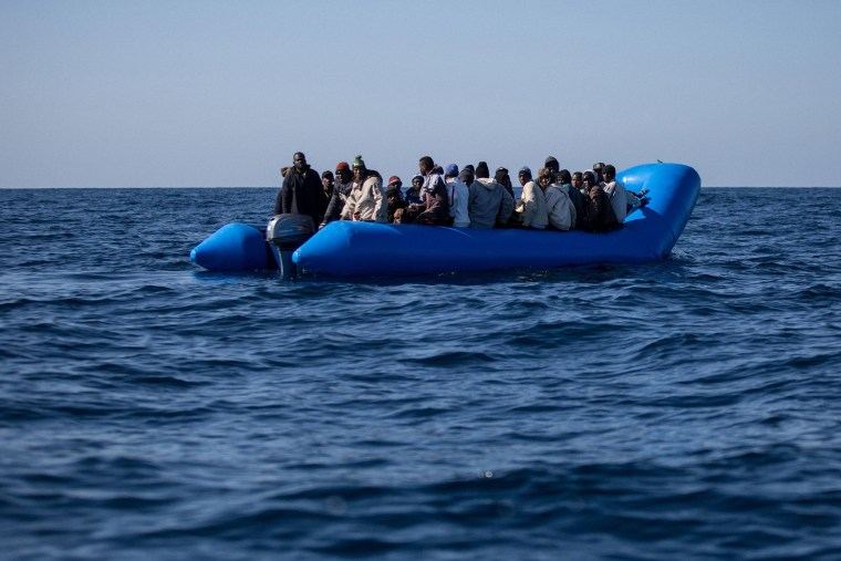 Image: An inflatable boat with 47 migrants on board is rescued by the Dutch-flagged Sea Watch 3 off Libya's coast