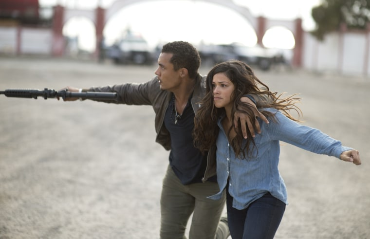 "Image: Gina Rodriguez and Ismael Cruz star in ""Miss Bala."""