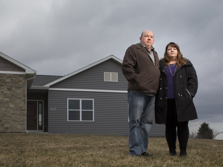 Kim and James Mahoney outside their Mount Pleasant, Wisconsin home.