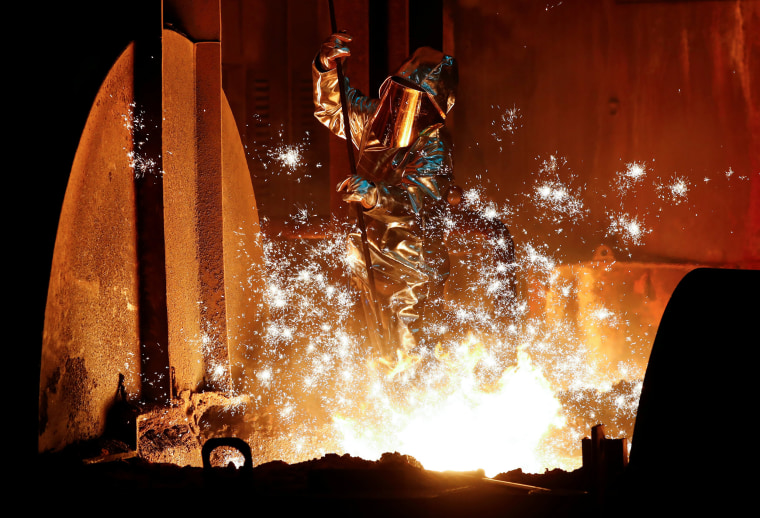 Image: A steel worker of Germany's industrial conglomerate ThyssenKrupp AG takes a sample of raw iron from a blast furnace at Europe's largest steel factory in Duisburg