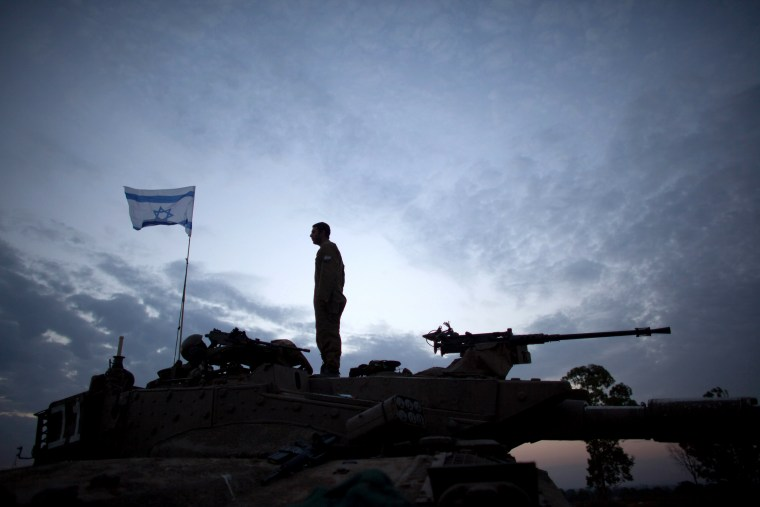 Image:  An Israeli soldier stands on a tank on Israel's border with Gaza Strip on Nov. 22, 2012.