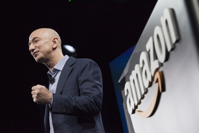 Image: Amazon CEO Jeff Bezos presents at an event in Seattle on June 18, 2014.