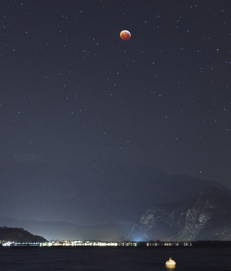 Title Lunar eclipse over Lake Maggiore Released 22/01/2019 4:56 pm Copyright Alberto Negro Description The lunar eclipse that took place in the early hours of Monday 21 January kicks off a major year for our satellite. This year marks the 50th anniversary of the Apollo 11 mission, the first crewed landing on the Moon.  After more than four decades, the Moon is again in the spotlight of space agencies worldwide as a destination for both robotic missions and human explorers.  But first, the lunar eclipse.  The phenomenon known as a total lunar eclipse occurs when the Earth passes directly between the Moon and the Sun, hiding the light that illuminates the surface of our satellite.