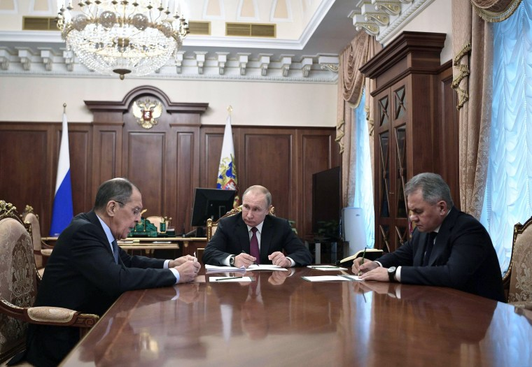 Image: Russian President Vladimir Putin meets with Defence Minister Sergei Shoigu and Foreign Minister Sergei Lavrov at the Kremlin in Moscow