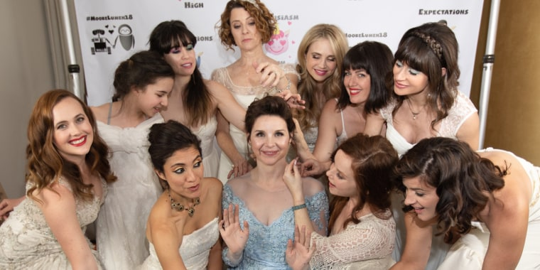 Bride asks guests to wear wedding dresses
