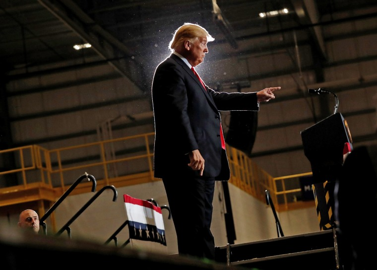 Image: United States President Trump gestures during a campaign rally in Pensacola