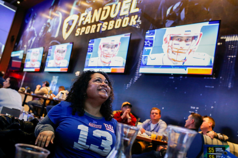 Image: Silquia Patel, 29, watches the game after making her bets at the FANDUEL sportsbook during the Super Bowl LIII in East Rutherford, New Jersey