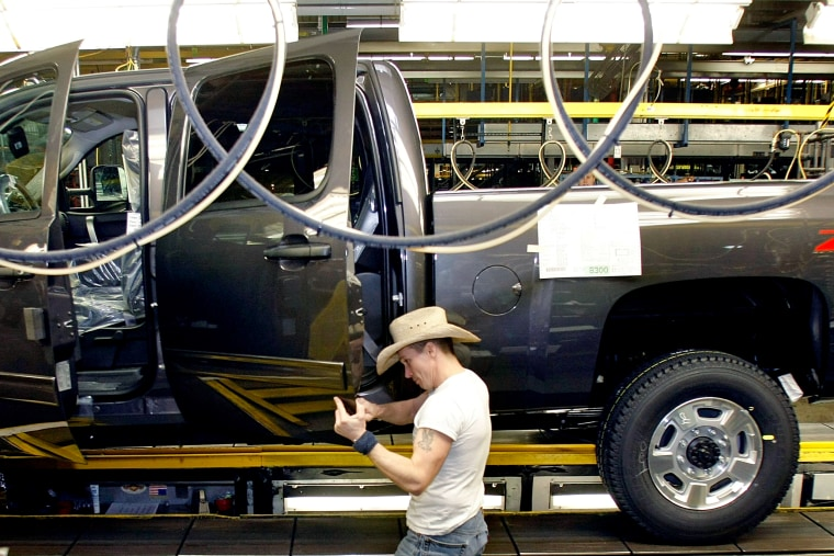 Image: An employee works on the assembly line at the General Motors Flint Assembly Plant in Michigan on Jan. 24, 2011.