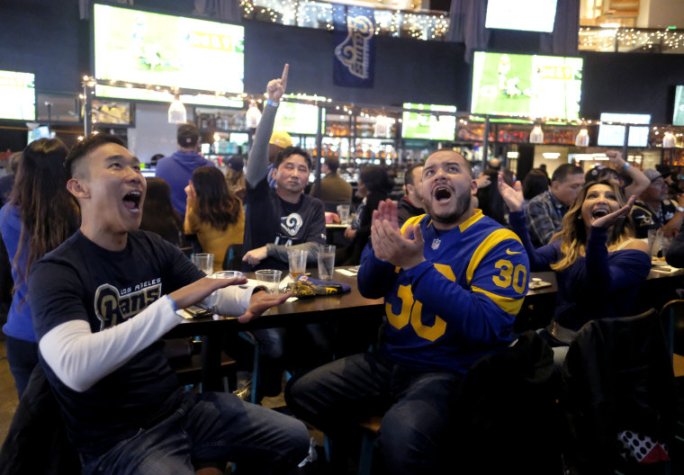 Image: Frank Luh, left, and Luis Merida watch the Super Bowl in Los Angeles on Feb. 3, 2019.