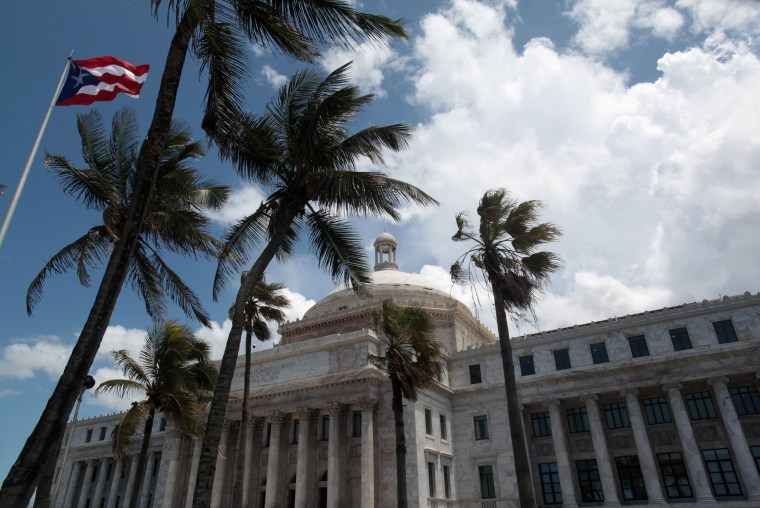 Image: FILE PHOTO: The flag of Puerto Rico flies outside the Capitol building in San Juan
