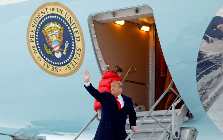 Image: U.S. President Donald Trump waves as he boards Air Force One as he departs for West Palm Beach, Florida, from Joint Base Andrews, Maryland