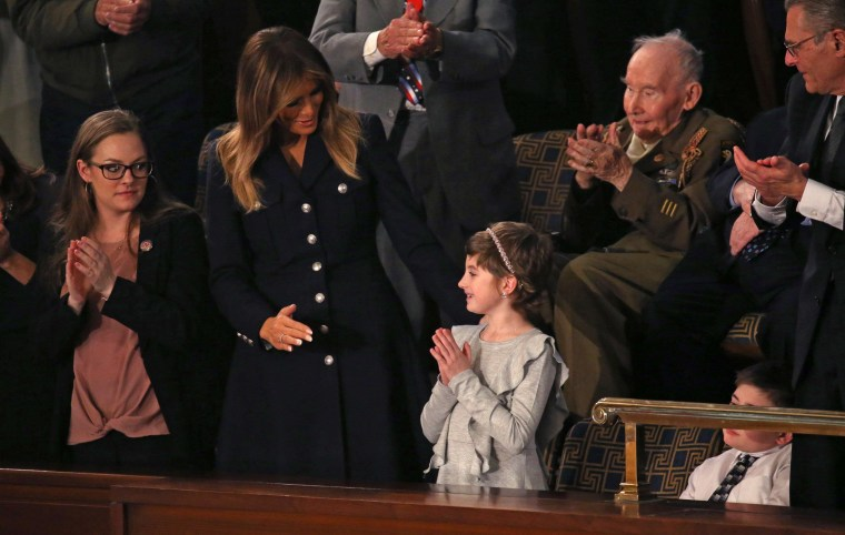 Image: First lady Melania Trump talks with cancer survivor Grace Eline as U.S. President Trump delivers his second State of the Union address to a joint session of the U.S. Congress in Washington