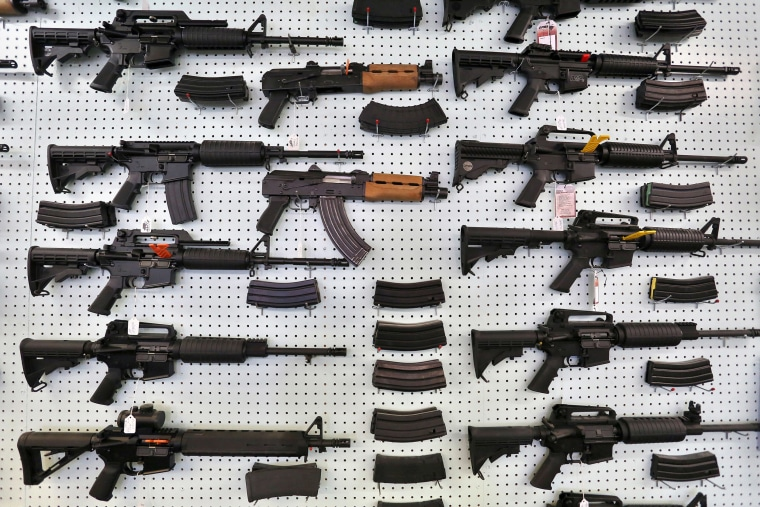 Image: Guns are displayed for sale at Dragonman's, an arms seller east of Colorado Springs