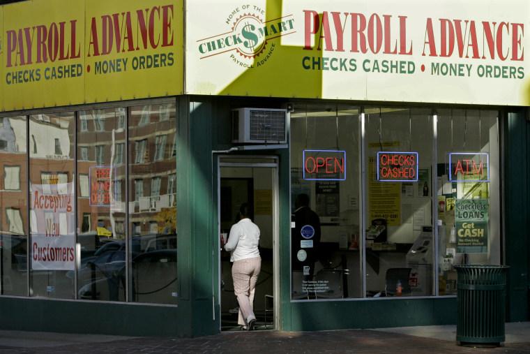 Image: A customer enters a Payroll Advance in Cincinnati, Ohio, in 2008.