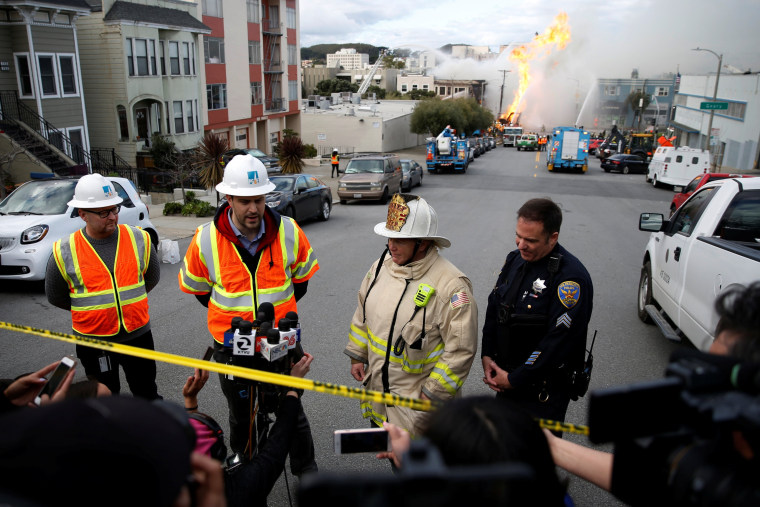 Image: Firefighters battles a fire after a gas line explosion in San Francisco