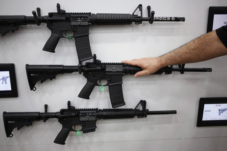 Image: AR-15 rifles are displayed on the exhibit floor during the National Rifle Association (NRA) annual meeting in Louisville, Kentucky