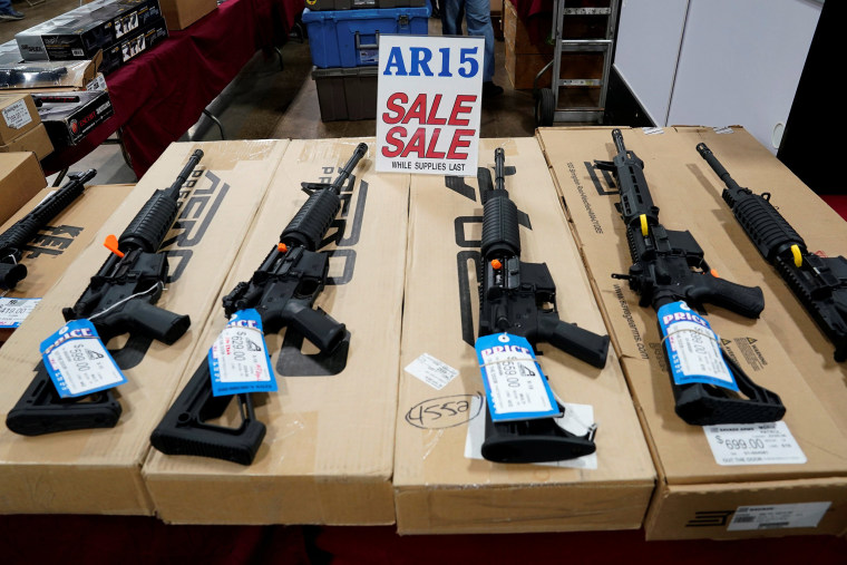 Image: AR-15 rifles on display at gun show