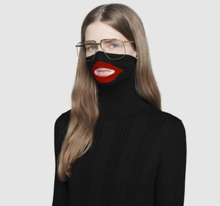 6515e46cd6d Image  An online fashion outlet showing a Gucci turtleneck black wool  balaclava sweater for sale