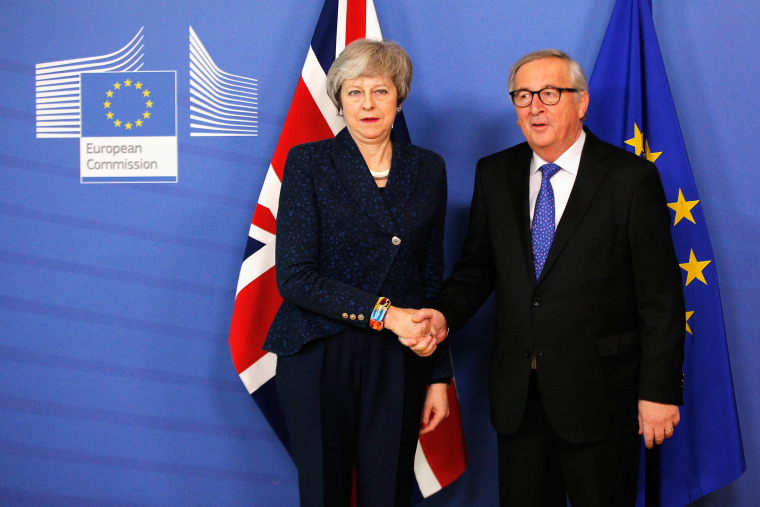 Image: Jean-Claude Juncker receives Theresa May in the VIP corner of The Berlaymont, the headquarters of the European Commission