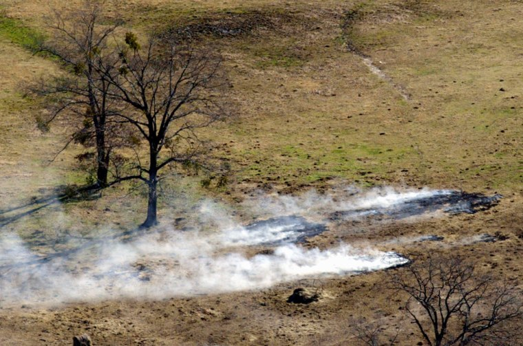 Image: brush fire started by a falling piece of debris