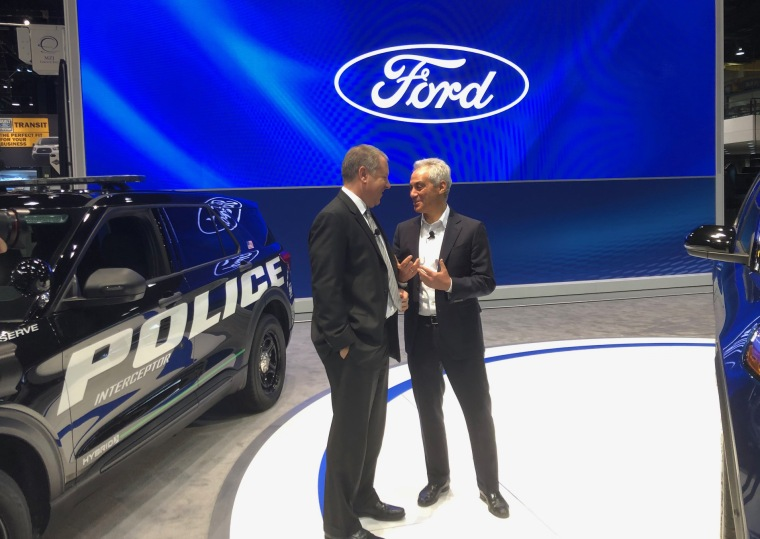 Image: Joseph R. Hinrichs, Ford's President of Global Operations, with Chicago Mayor Rahn Emanuel, after the auto giant announced a $1 billion investment in the Windy City.