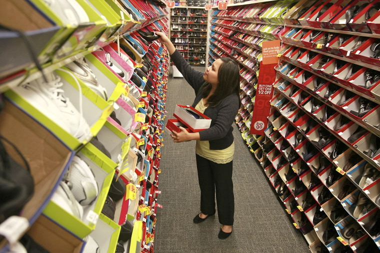 A customer looks to buy new shoes for a new sales associate job, at the Payless ShoeSource in Los Angeles on Oct. 4, 2010.