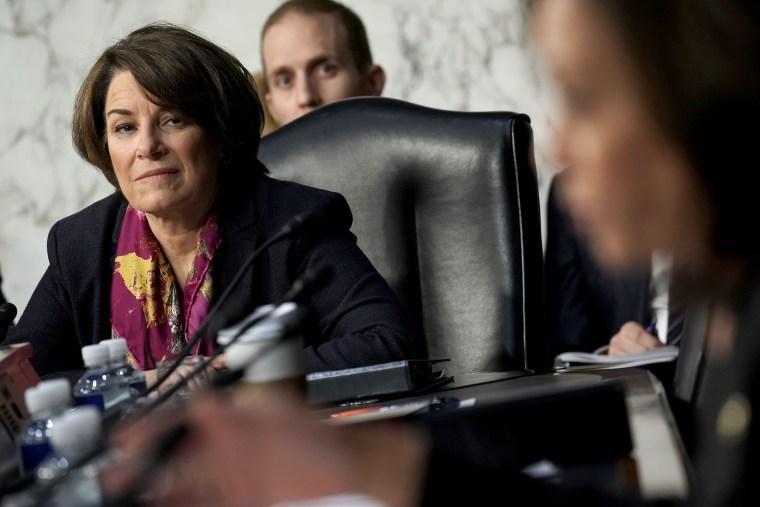Image: Sen. Amy Klobuchar, D-Minn., listens to testimony at a hearing in Washington on Jan. 15, 2019.