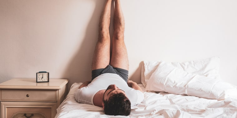 Man Resting On Bed At Home