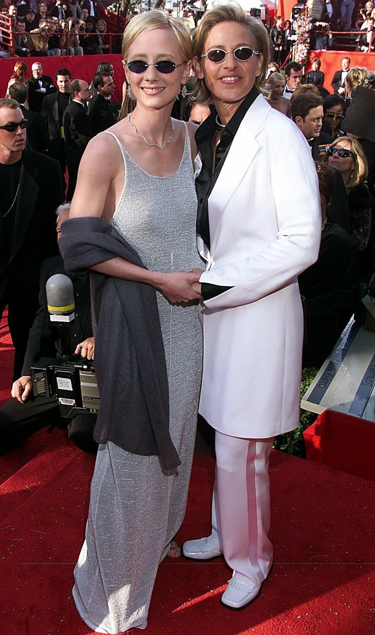 LOS ANGELES, UNITED STATES:  This 21 March 1999 file photo shows US comedian Ellen DeGeneres (R) with partner US actress Anne Heche (L) upon their arrival at the Dorothy Chandler Pavilion for the 71st Annual Academy Awards 21 March 1999 in Los Angeles, California. Heche was reported to have been hospitalized 19 August 2000 in Fresno, California, hours after her breakup with Ellen DeGeneres became public, a sheriff's deputy confirmed 21 August 2000.   (ELECTRONIC IMAGE)  AFP PHOTO/Lucy NICHOLSON (Photo credit should read LUCY NICHOLSON/AFP/Getty Images)