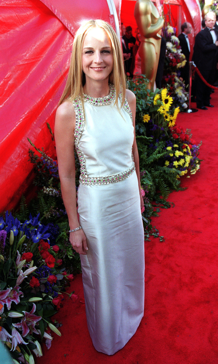 American actress Helen Hunt arrives at the Dorothy Chandler Pavilion in Los Angeles for the 71st annual Academy Awards, wearing a long cream Gucci evening dress.   (Photo by Peter Jordan - PA Images/PA Images via Getty Images)