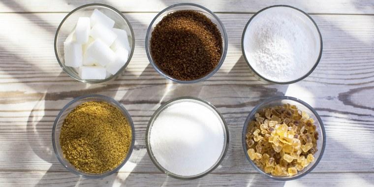 Glasses of sugar in various forms, overhead view