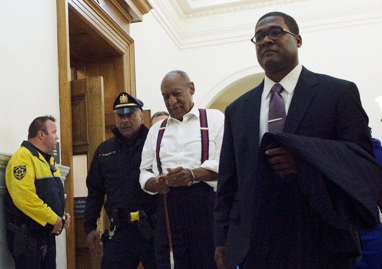 Image: Bill Cosby, center, leaves the courtroom after he was sentenced to three-to 10-years for felony sexual assault