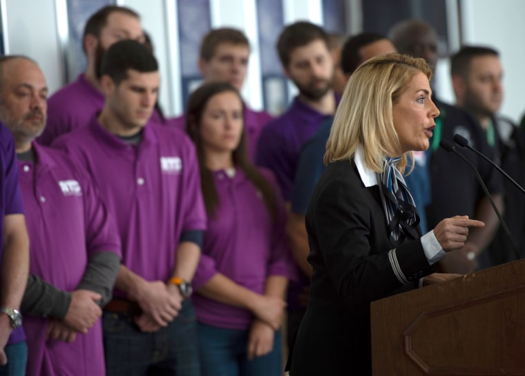 Image: Sara Nelson, the International President of the Association of Flight Attendants, speaks during a press conference on aviation safety during the government shutdown at Reagan National Airport in Virginia on Jan. 24, 2019.
