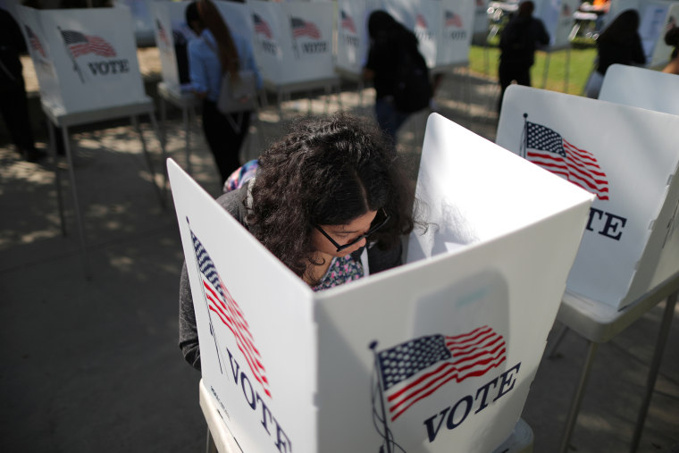 A first time voter casts her ballot during the midterm elections in Norwalk,