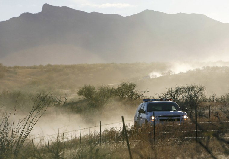 A U.S. Border Patrol vehicle returns from the scene of an overnight shootout where Border Patrol Agent Brian Terry was killed northwest of Nogales, Ariz.