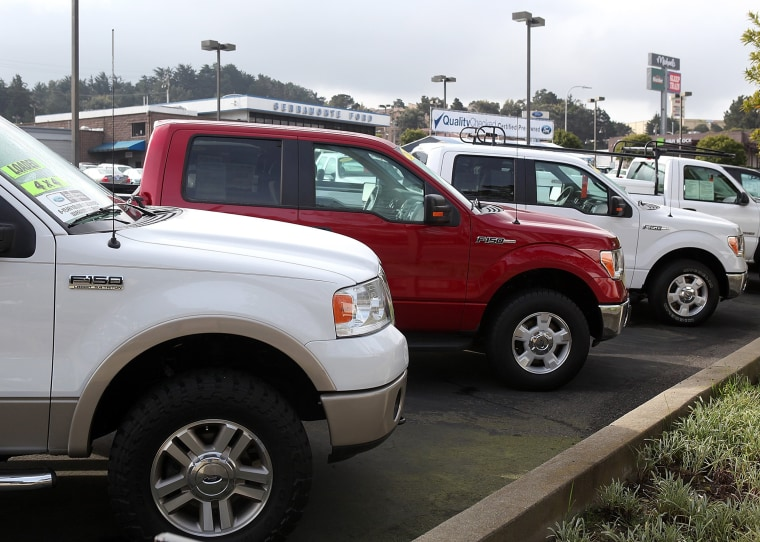 Image: Ford F-150 pickup trucks sit on the sales lot at Serramonte Ford