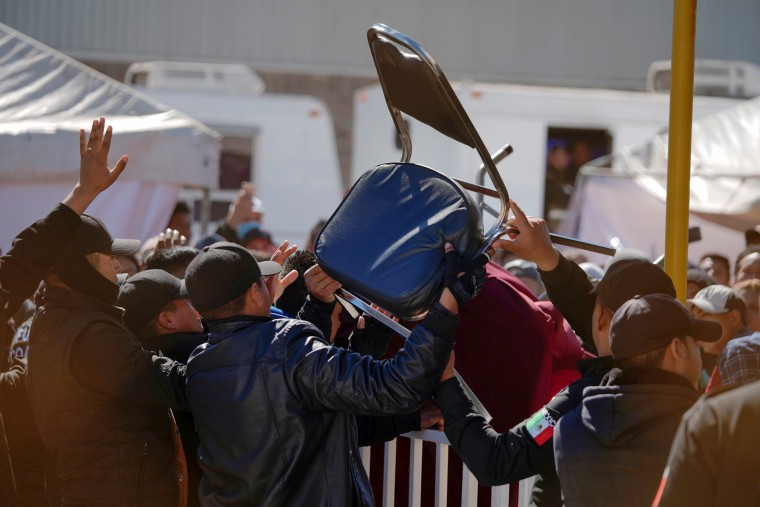 Image: Migrants clash with security agents at a provisional shelter in Piedras Negras, Mexico, on Feb. 13, 2019.