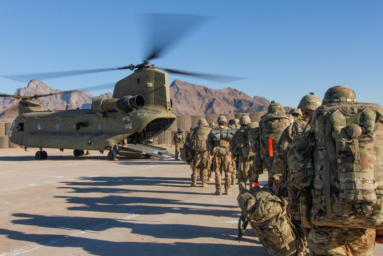 Image: Soldiers attached to the 101st Resolute Support Sustainment Brigade, Iowa National Guard and 10th Mountain, 2-14 Infantry Battalion, load onto a Chinook helicopter to head out on a mission in Afghanistan