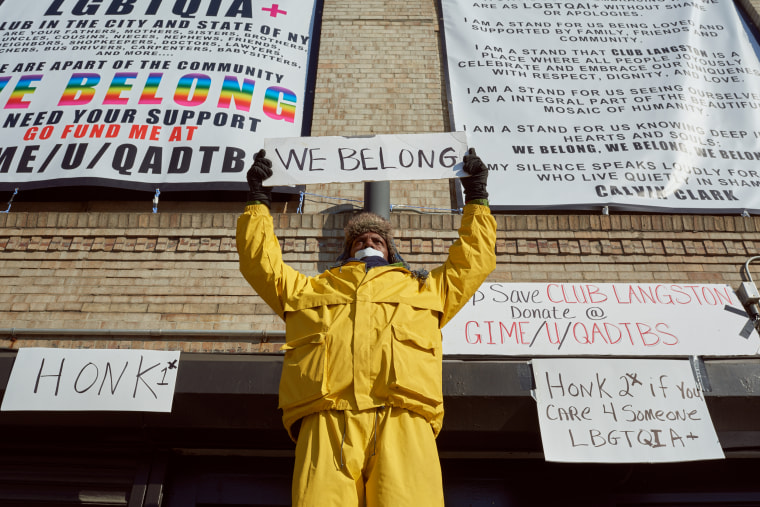 Calvin Clark stands in front of Club Langston in a silent protest in Brooklyn, New York.