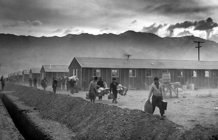 Image: A group of Japanese-Americans arrive at the Manzanar internment camp in Owens Valley, California, on March 21, 1942.