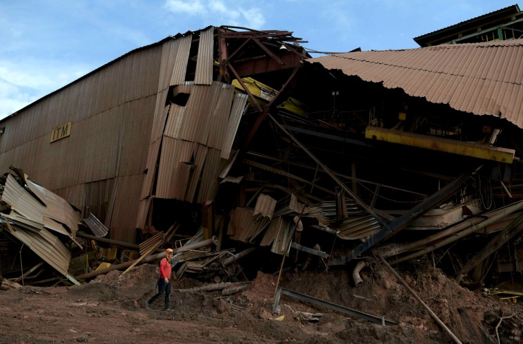 Image: A rescuer walks past a collapsed Vale SA dam in Brumadinho, Brazil, on Feb. 13, 2019.