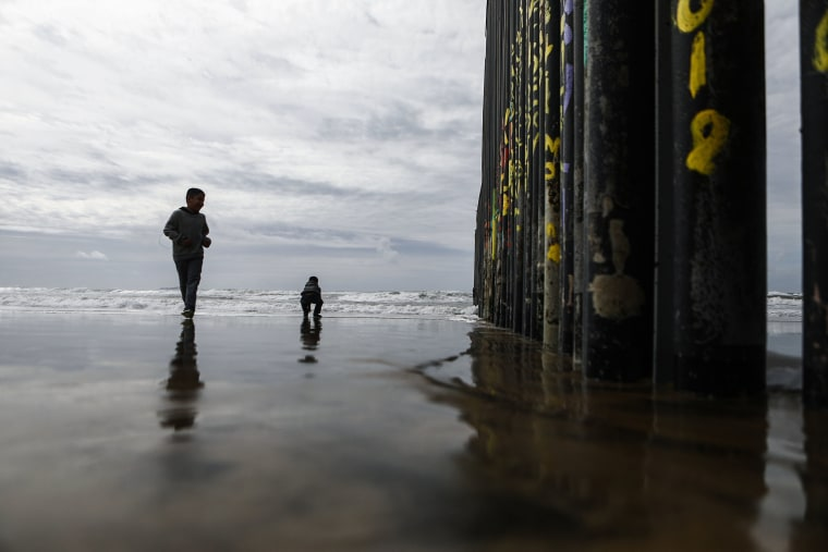 Image: People gather on the U.S.-Mexico border barrier on the beach at the Pacific ocean on Feb. 15, 2019 in Tijuana, Mexico