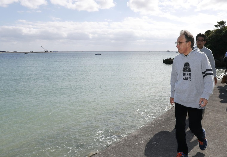 Image: Okinawa Gov. Denny Tamaki walks near the site of full-fledged offshore landfill work in Nago, Okinawa Prefecture