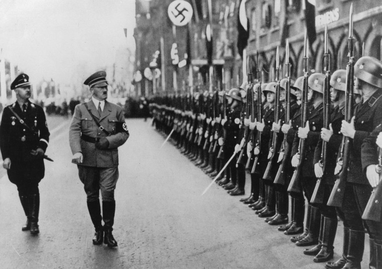 Image: Adolf Hitler and the head of the SS, Heinrich Himmler, walking past a guard of honor in Nuremberg, September 1935