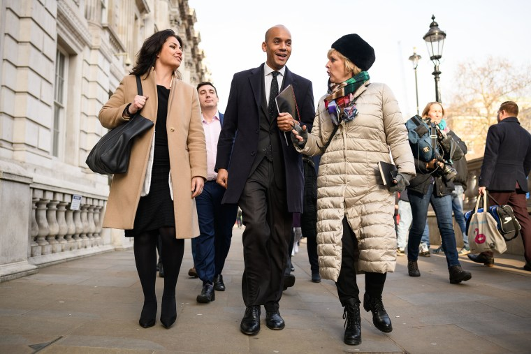 Image: Labour MP Chuka Umunna walks with Conservative MPs Heidi Allen, left, and Anna Soubry, right, as they leave the Cabinet Office following a Brexit meeting