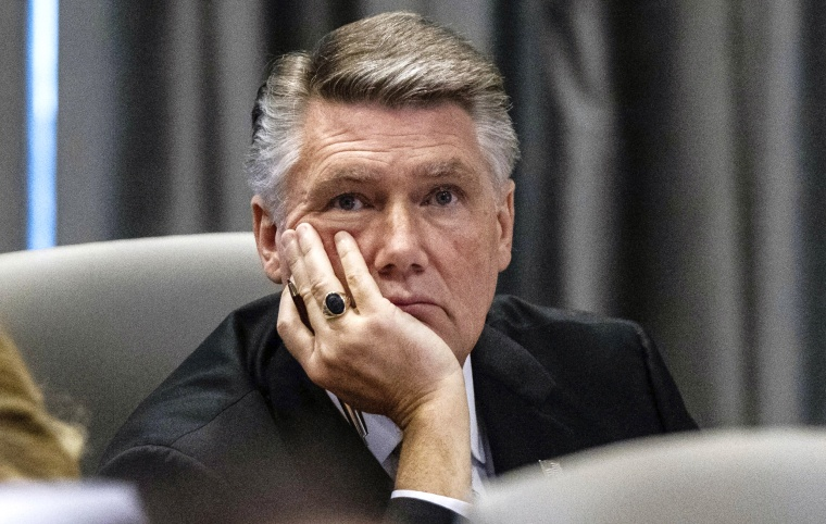 Image: Mark Harris, Republican candidate for North Carolina's 9th Congressional District, listens to testimony during a hearing on voting irregularities on Feb. 19, 2019.